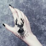 hand tattooed deer